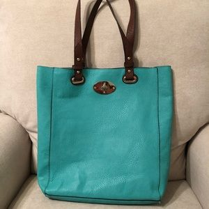 Bags - Teal shoulder purse with accessories.